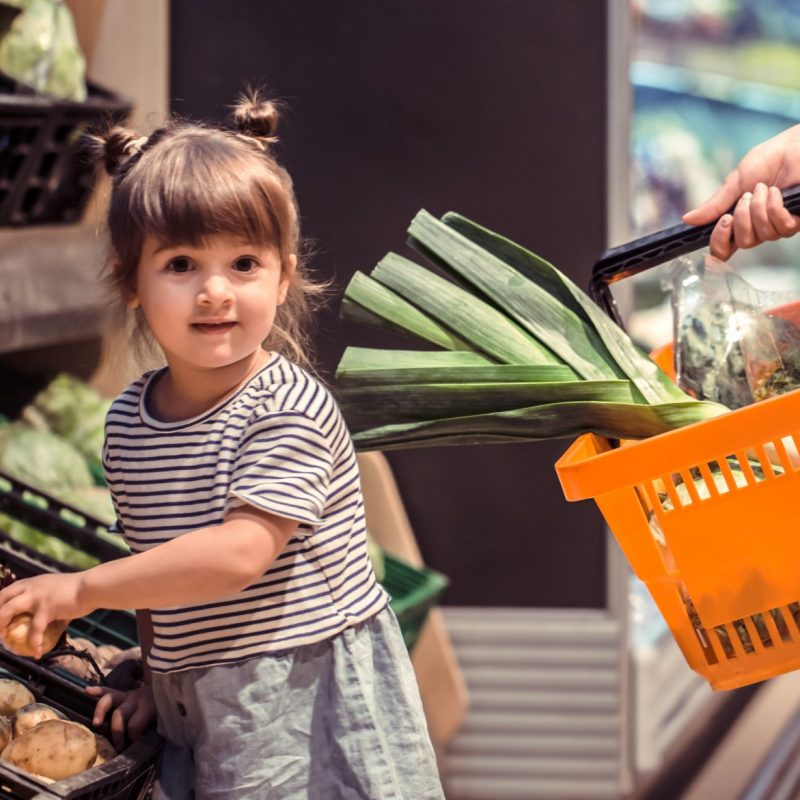 Mom and daughter are shopping at the supermarket, the concept of family relationships and healthy eating